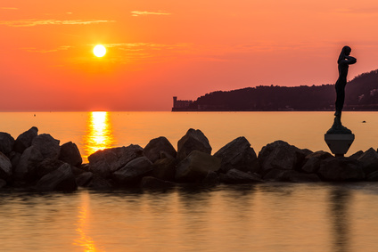 sunset behind the castle of Trieste